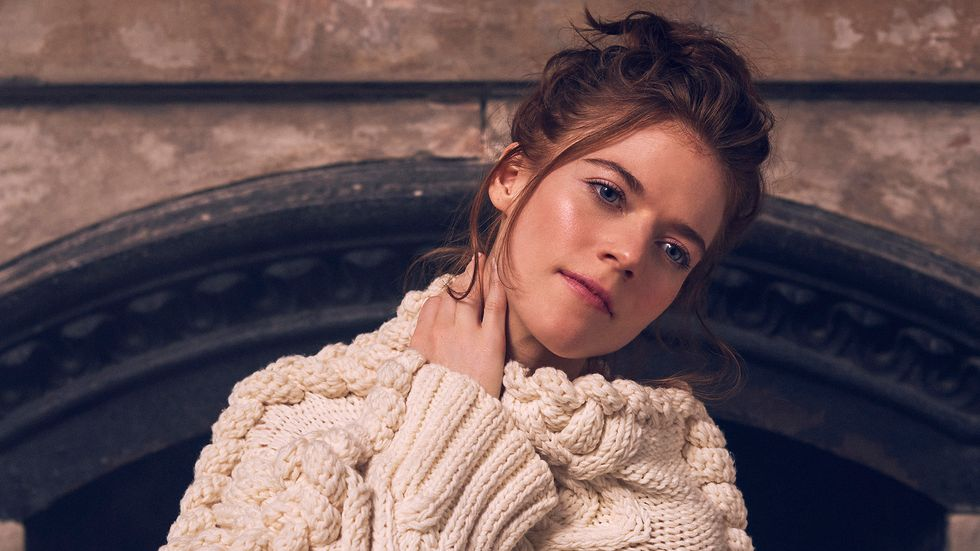 Rose Leslie of The Good Fight in a chunky white sweater