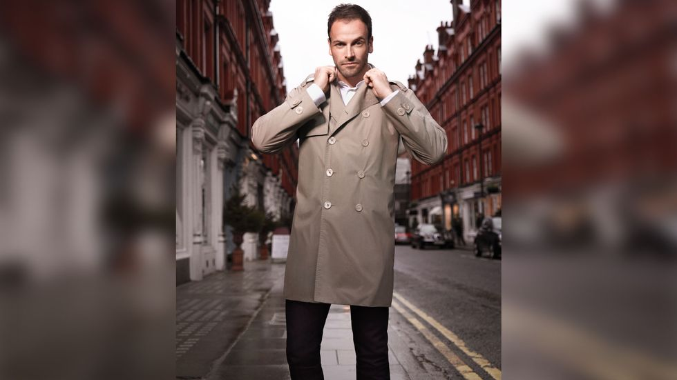 Jonny Lee Miller of Elementary turning up the collar on his trench coat