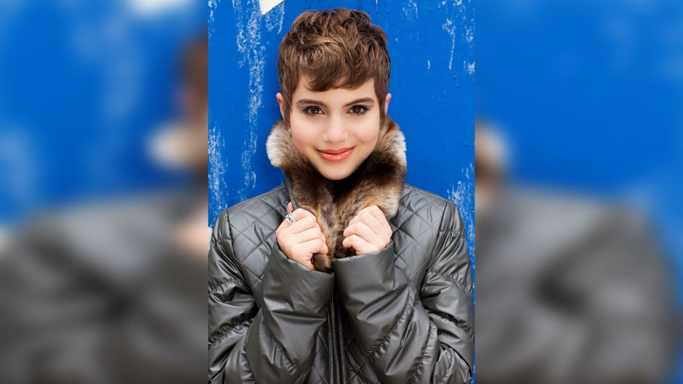 Sami Gayle of Blue Bloods in a fur trimmed puffy coat