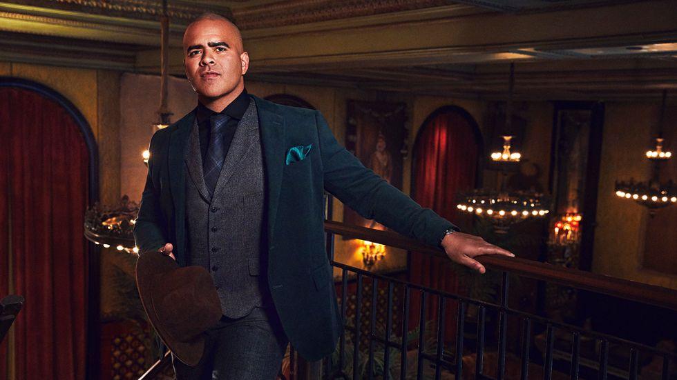 Chris Jackson of Bull in a tweed vest and blue velvet coat