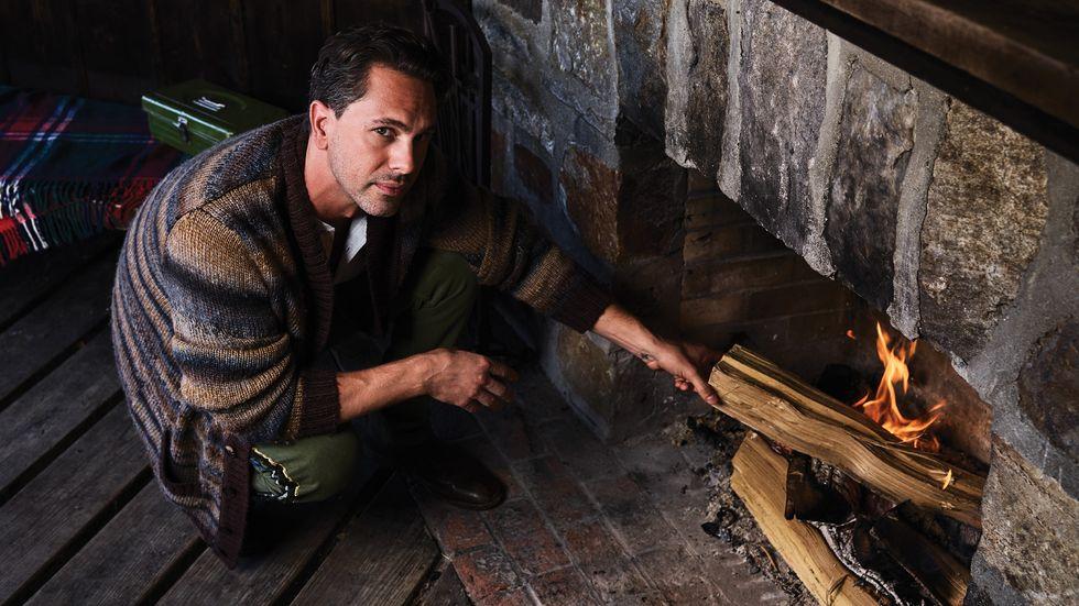 Thomas Sadoski of Life in Pieces stoking a fire