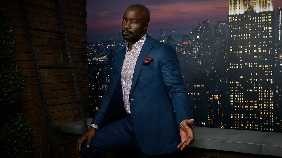 Mike Colter in front of New York City scene