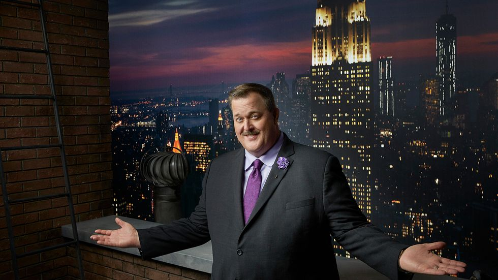 Billy Gardell in purple tie in front of the Empire State Building