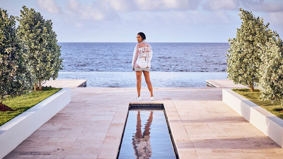 Candice Patton posing by infinity pool