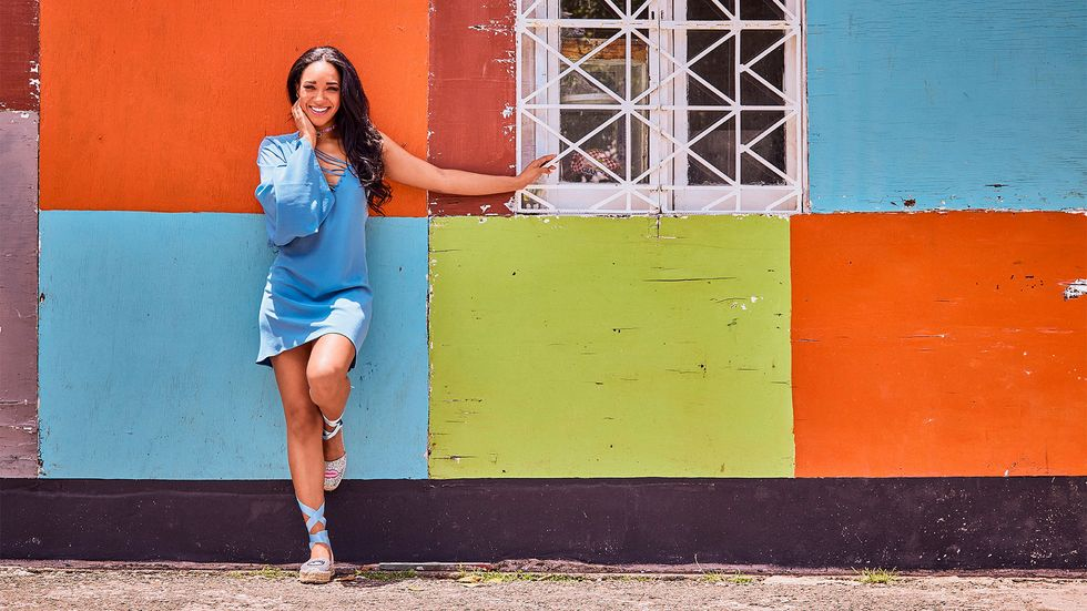 Candice Patton posing against color blocked wall