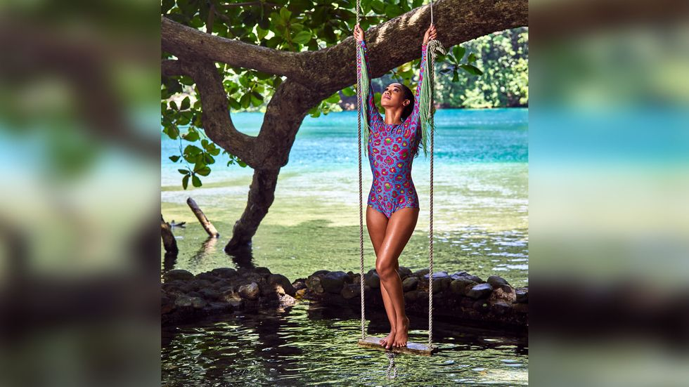 Candice Patton on tree swing by the water