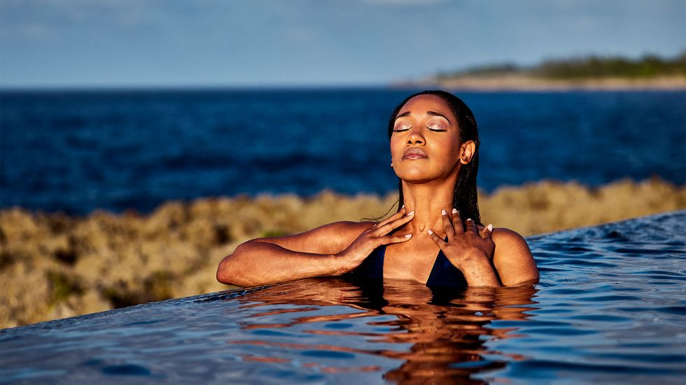 Candice Patton swimming in infinity pool
