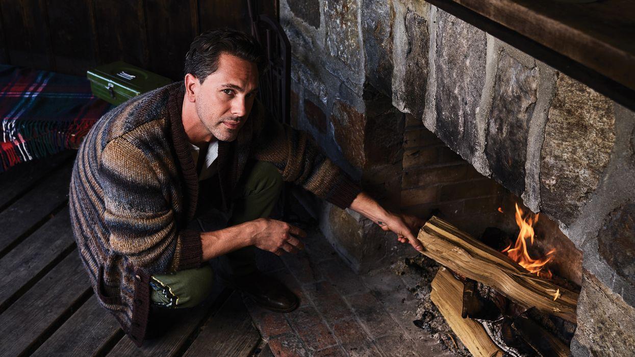Thomas Sadoski making a fire.
