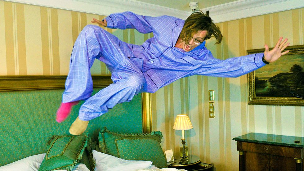 Matthew Gray Gubler in pajamas jumping on a bed