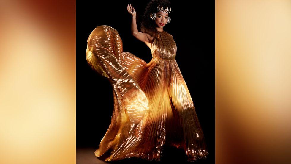 Sonequa Martin Green in a golden dress and crown