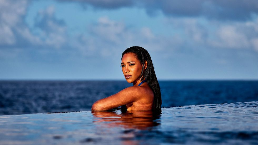 Candice Patton posing in infinity pool