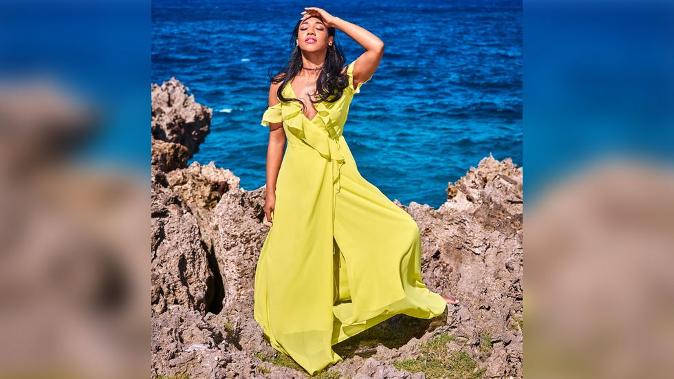 Candice Patton posing in bright yellow dress