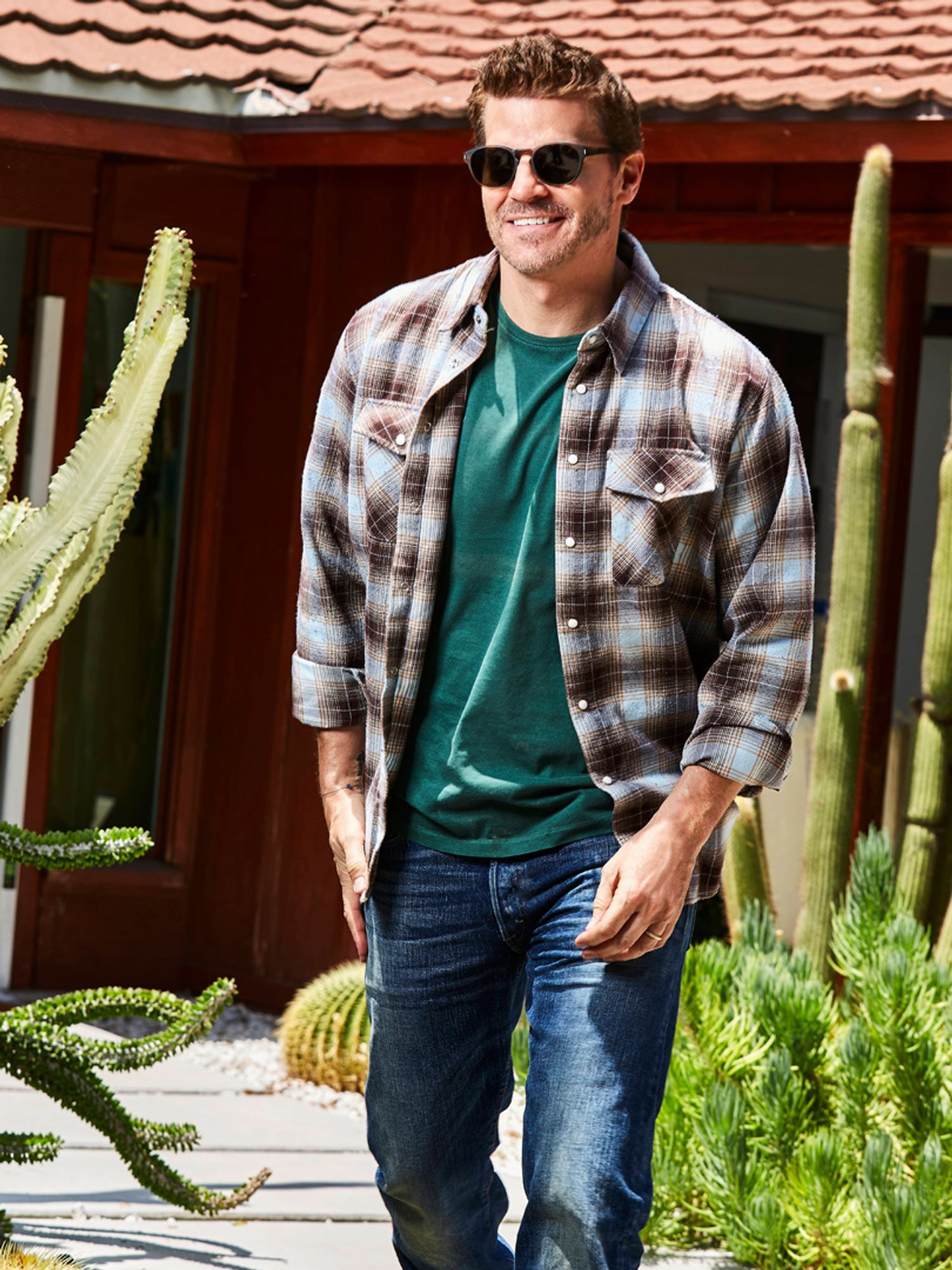 David Boreanaz of SEAL Team in a plaid shirt and jeans