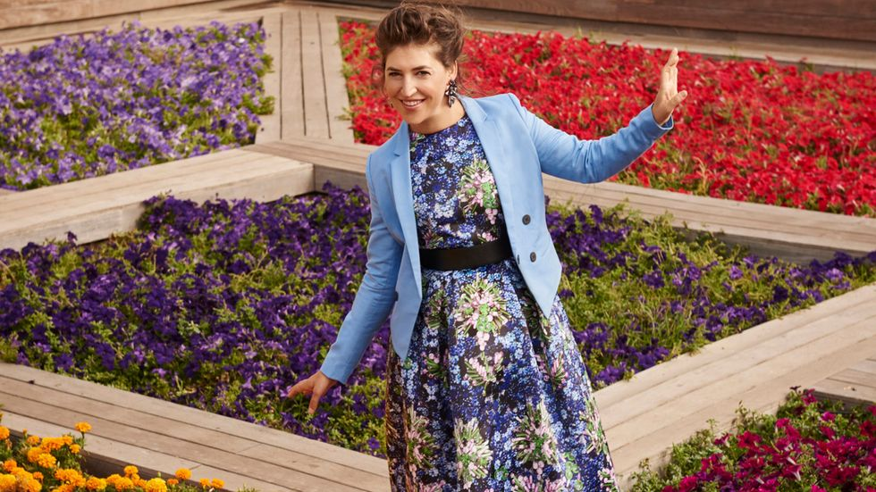 Mayim Bialik of The Big Bang Theory in blue and purple floral dress
