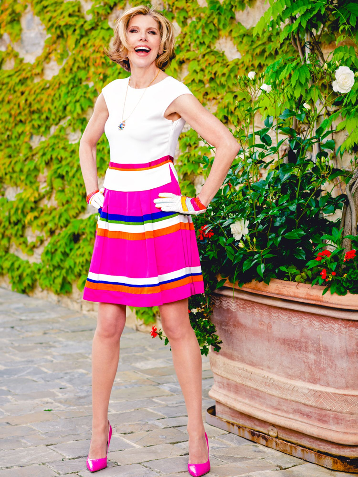Christine Baranski of The Good Fight in a pink striped skirt and pink heels