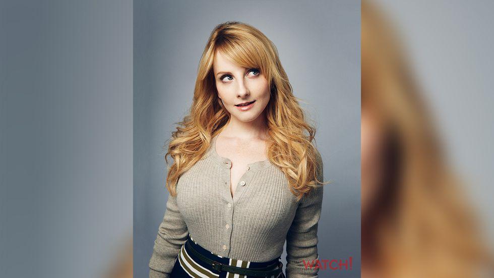Melissa Rauch wearing a beige sweater