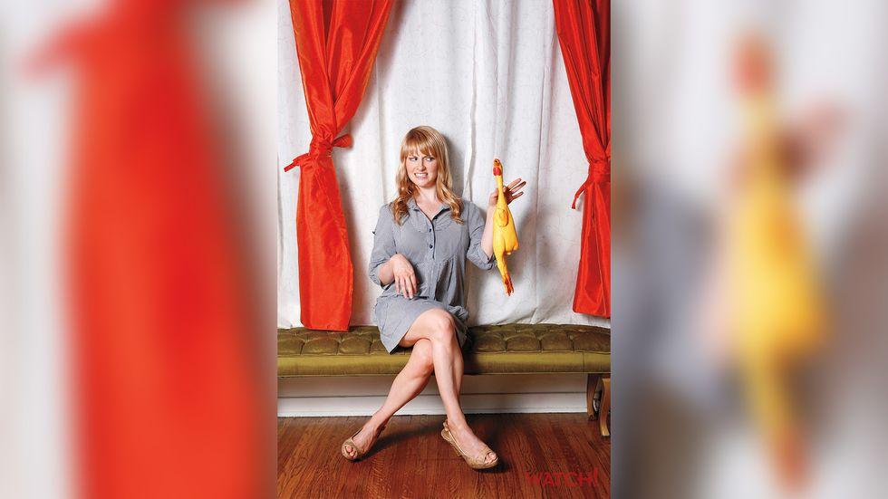 Melissa Rauch holding a rubber chicken