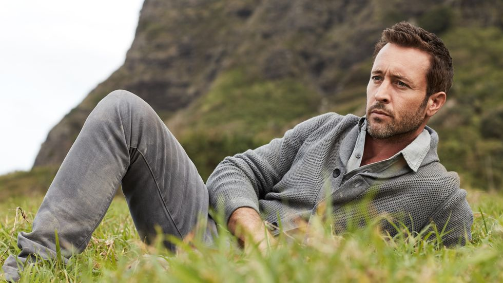 Alex OLoughlin relaxing in the meadow