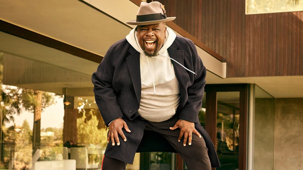 Cedric the Entertainer of The Neighborhood in hoodie and fedora