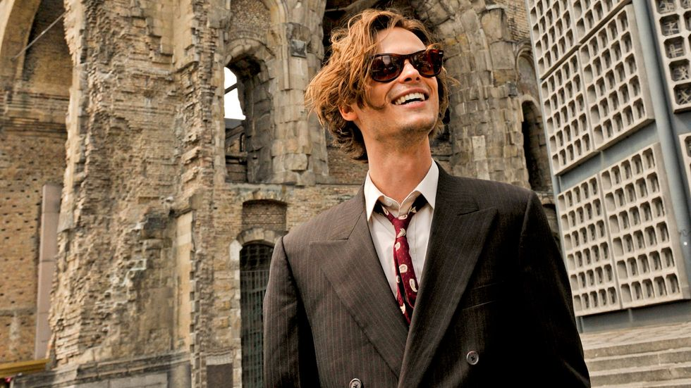 Matthew Gray Gubler of Criminal Minds in brown suit with sunglasses