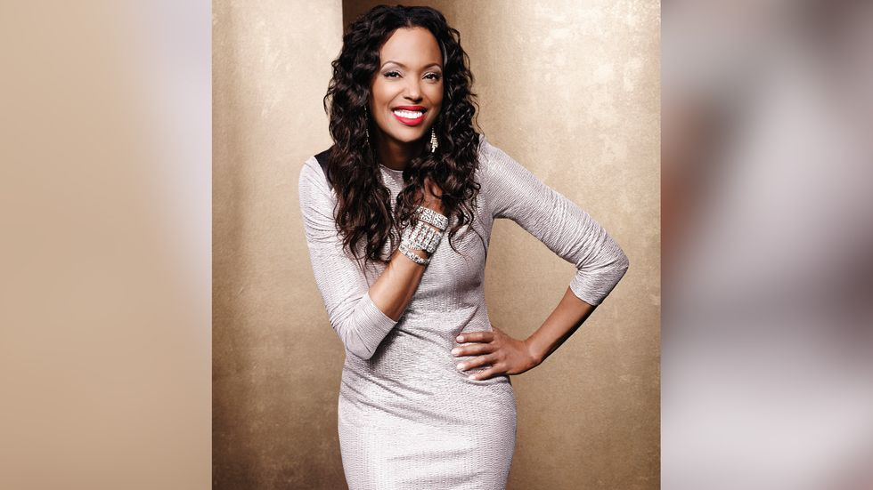 Aisha Tyler of Criminal Minds in sparkly dress with stacked bracelets