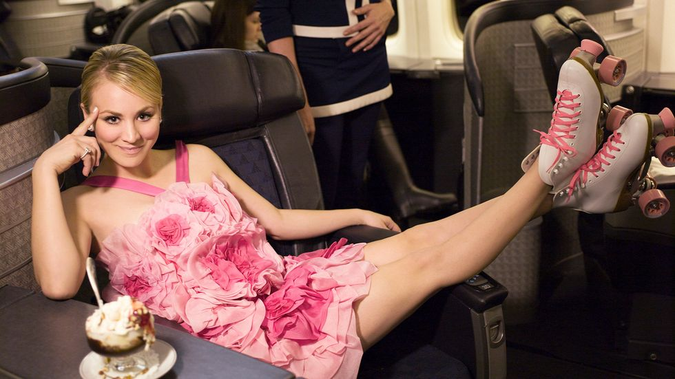 Kaley Cuoco of The Big Bang Theory in pink dress with her feet up