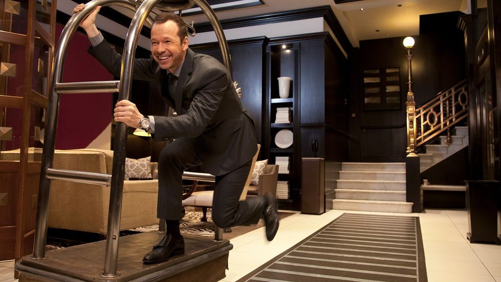 Donnie Wahlberg of Blue Bloods riding a hotel luggage cart