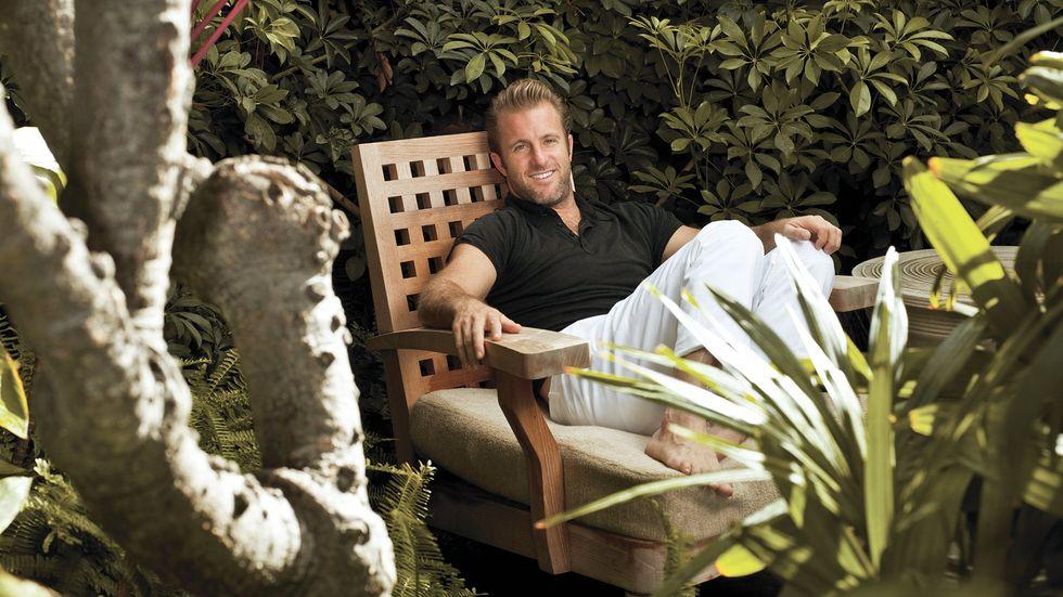 Scott Caan of Hawaii Five 0 in black shirt and chinos in garden