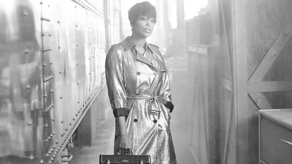 aisha tyler wearing silver metallic trench coat