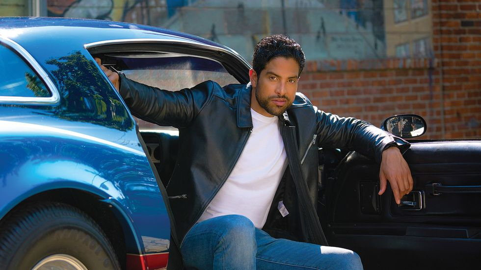 Adam Rodriguez in leather jacket