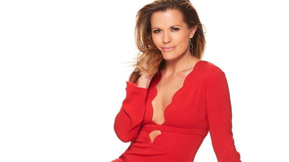 Melissa Claire Egan poses in a plunging neckline red dress.