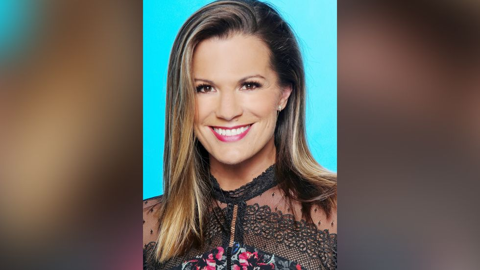 Melissa Claire Egan wears a lace and flowered top.