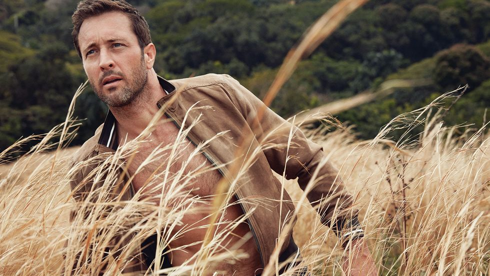 Alex O'Loughlin in a wheat field