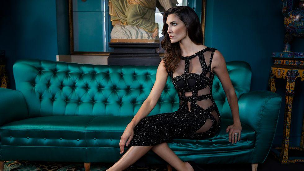 Daniela Ruah of NCIS Los Angeles in black sheer cutout dress