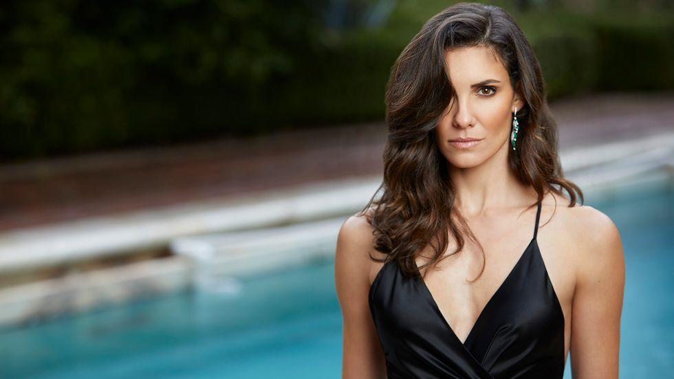 Daniela Ruah of NCIS Los Angeles in black spaghetti strap dress