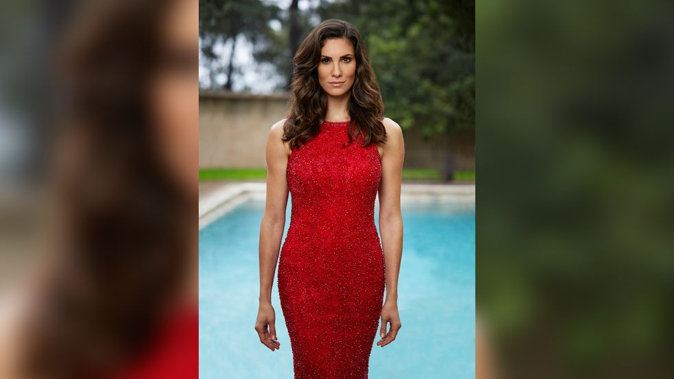 Daniela Ruah of NCIS Los Angeles in red sleeveless beaded dress