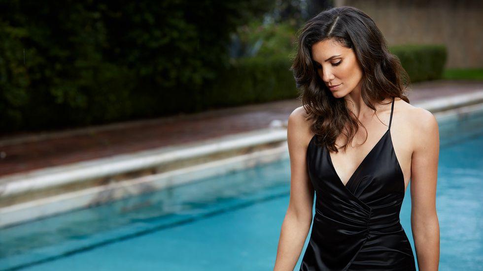 Daniela Ruah of NCIS Los Angeles in black gown