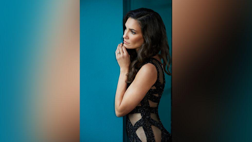 Daniela Ruah of NCIS Los Angeles in sheer black dress