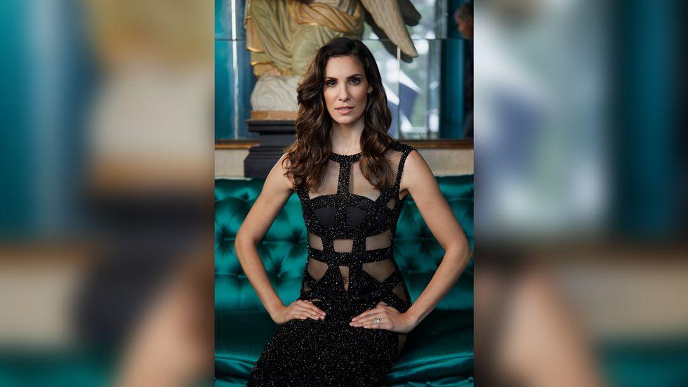 Daniela Ruah of NCIS Los Angeles in sheer glittery black dress