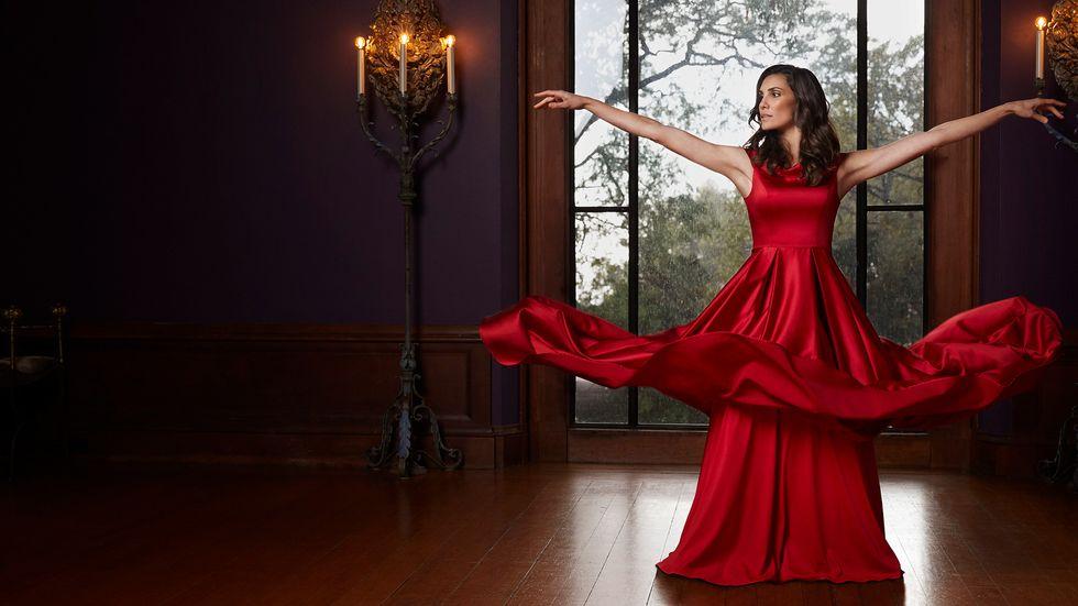 Daniela Ruah of NCIS Los Angeles in red satin ballgown