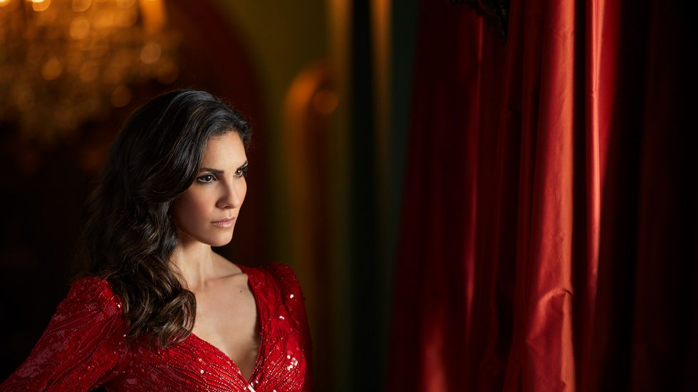 Daniela Ruah of NCIS Los Angeles in embellished red gown