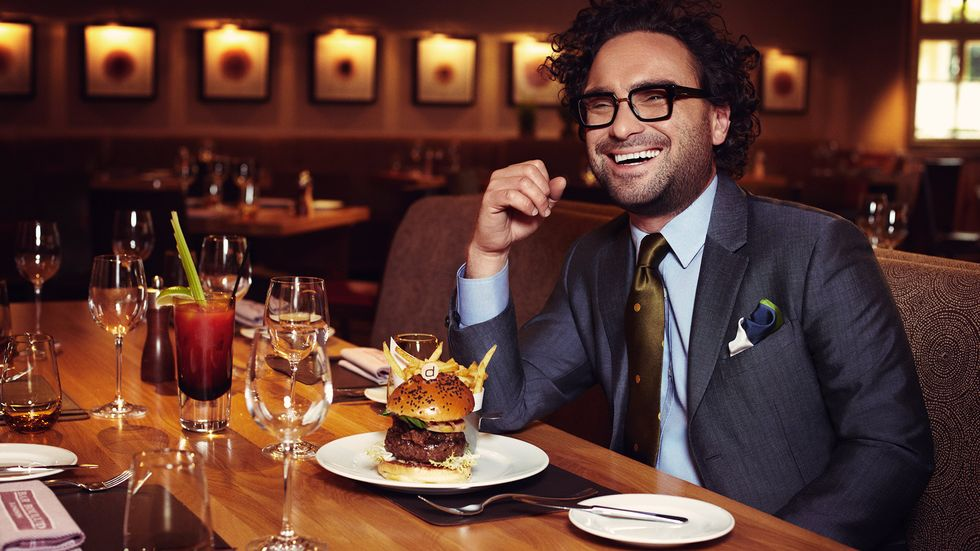 Johnny Galecki eating a burger and fries