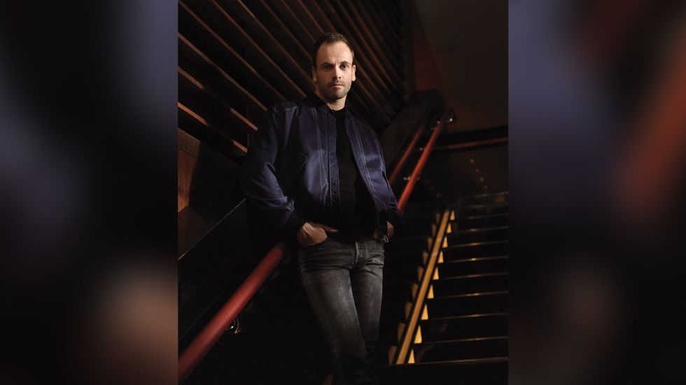 Jonny Lee Miller look handsome on staircase