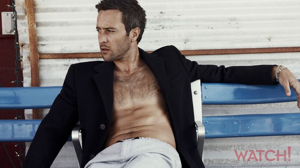 Alex OLoughlin of Hawaii Five 0 shirtless sitting on a bench