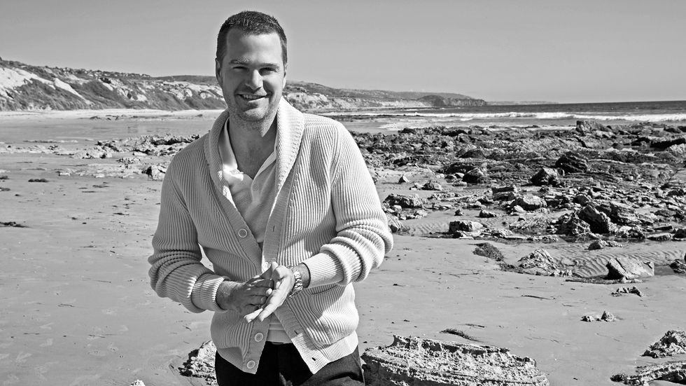 Chris O'Donnell on a rocky beach