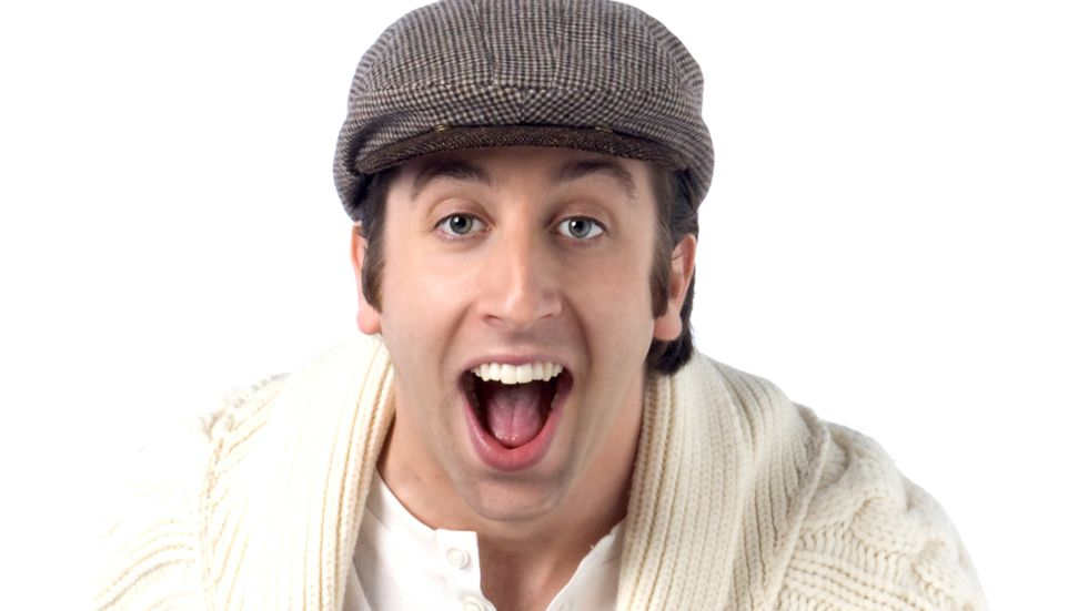 Simon Helberg lauding with white sweater