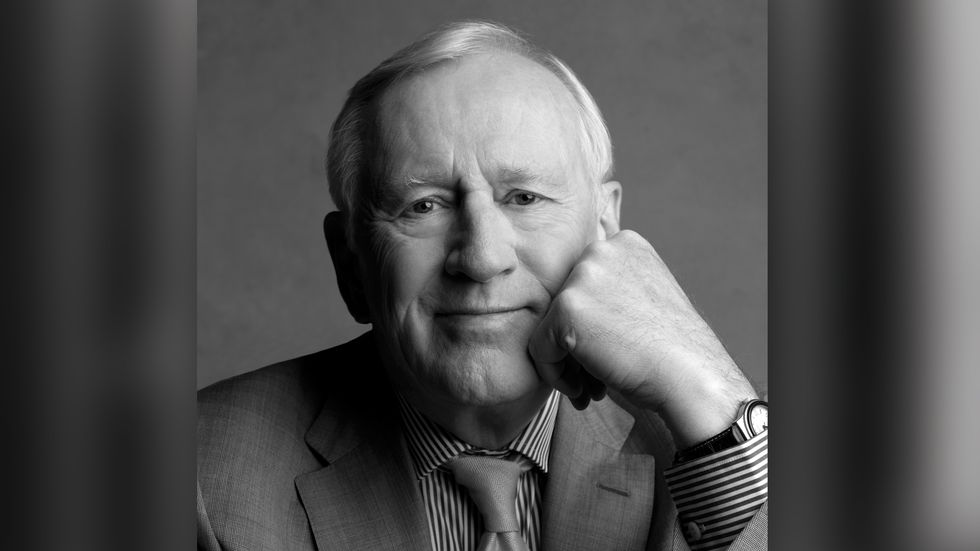 Len Cariou close up in grey suit and tie