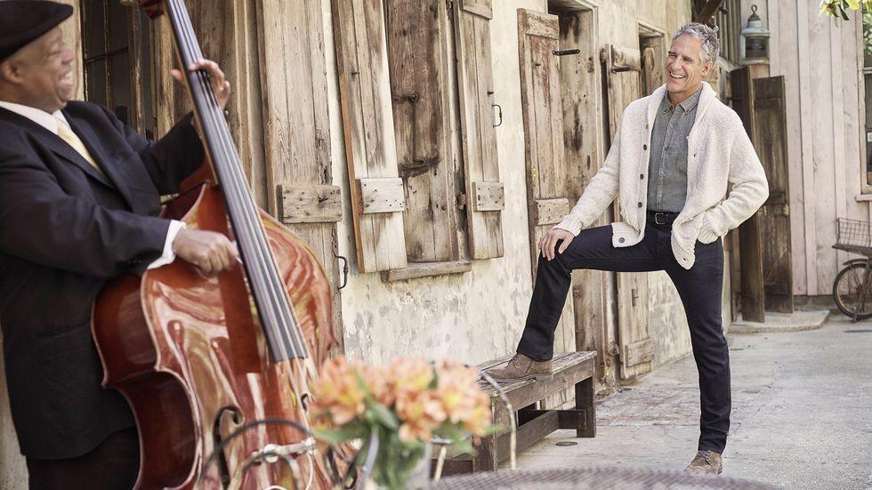 Scott Bakula with watching cellist