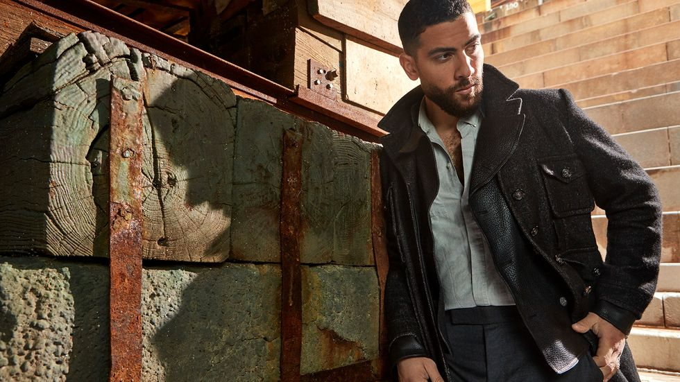 Zeeko Zaki in leather trenchcoat