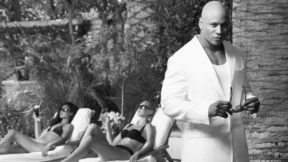 LL COOL J wears a white suit poolside